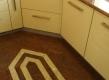 """Stara kuhinja je renovirana potpuno novim elementima, ali točku na """"i"""" stavila je granitna kuhinjska radna ploča. Vrhunsku radnu ploču osim lijepog prirodnog izgled karakterizira lakoća održavanja i dugovječnost. Osim radne ploče, isti kamen ugrađen je i na pod, sa umecima svjetlijeg granita."""